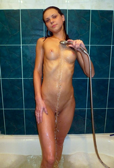 The naked student washes her body