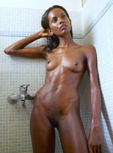 A young girl from Africa in the shower a sexy skinny body small tits and tight dark..