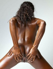 Naked young and very beautiful black woman showing strong hard black ass little black..