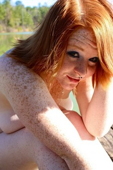 Redhead girl in freckles nude outdoor