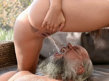 Chick peeing in to grandpa's wide open mouth